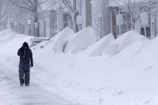 On the city's south side, the scenes captured in these Associated Press photos are even scarier. There used to be cars on this street. You can barely see them now; there are only snow drifts.