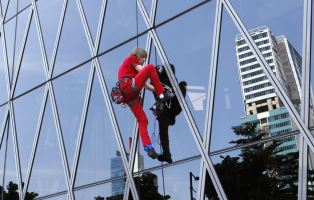French climber Alain Robert, a rock climber who has become famous for climbing known buildings worldwide, climbs the 215m (705 feet) high, 50 floors Bakrie Tower building in Jakarta March 25, 2012. REUTERS