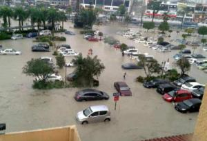 Water, water everywhere: Cars are partially submerged in floodwaters at the car park of IOI Mall.(The Star)