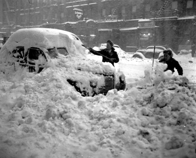 1947: Two men dig out a car after a record-breaking snowfall of 26.4 inches in New York City. (AP Photo)