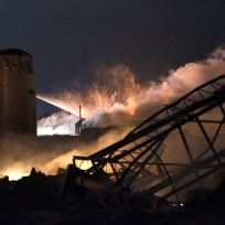 Smoke rises as water is sprayed at the burning remains of a fertilizer plant after an explosion at the plant in the town of West, near Waco, Texas early April 18, 2013. The deadly explosion ripped through the fertilizer plant late on Wednesday, injuring more than 100 people, leveling dozens of homes and damaging other buildings including a school and nursing home, authorities said. REUTERS/Mike Stone