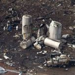 An aerial view shows investigators walking through the aftermath of a massive explosion at a fertilizer plant in the town of West, near Waco, Texas April 18, 2013. The death toll in the explosion at the plant has reached 14 people, Mayor Tommy Muska said on Thursday. Among the 14 are four emergency medical technicians killed in the blast, which occurred on Wednesday evening after emergency responders rushed to put out a fire at the plant. REUTERS/Adrees Latif (UNITED STATES - Tags: DISASTER ENVIRONMENT AGRICULTURE)