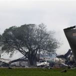 The remains of a fertilizer plant smolder after a massive explosion in the town of West, near Waco, Texas April 18, 2013. REUTERS/Mike Stone