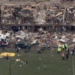 Police and rescue workers stand near a building which was left destroyed from a massive explosion at a nearby fertilizer plant in the town of West, near Waco, Texas April 18, 2013. REUTERS/Adrees Latif