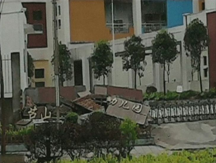 "A view of a collapsed building with a sign reading, ""Lushan Kindergarden"" after a 6.6 magnitude earthquake hit southwestern China's Sichuan province is seen in this April 20, 2013 still image taken from TV. The earthquake hit the province on Saturday, killing at least 28 people and injuring at least 100 close to where a big quake killed almost 70,000 people in 2008. REUTERS/China Central Television (CCTV) via REUTERS TV"
