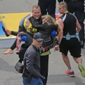 Emergency personnel respond to the scene after two explosions went off near the finish line of the 117th Boston Marathon on April 15, 2013. (Photo by David L. Ryan/The Boston Globe via Getty Images)