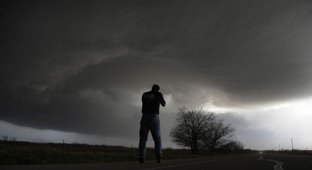 Storm chaser Brad Mack from Buena Park California videotapes a rotating supercell storm west of Newcastle, Texas April 9, 2013. Many of the storms in Tornado Alley that were forecast to be severe this week were taken out by a cold front from Canada. Picture taken April 9, 2013. REUTERS/Gene Blevins (UNITED STATES - Tags: ENVIRONMENT TPX IMAGES OF THE DAY)