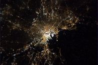 Boston at night, glowing under a trace of fog.
