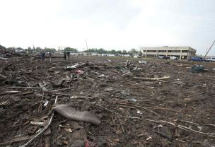 Parts of trees and household debris cover the ground after a huge tornado struck Moore, Oklahoma, near Oklahoma City, May 20, 2013. A massive tornado tore through the Oklahoma City suburb of Moore on Monday, killing at least 51 people as winds of up to 200 miles per hour (320 kph) flattened entire tracts of homes, two schools and a hospital, leaving a wake of tangled wreckage. REUTERS/Richard Rowe (UNITED STATES - Tags: DISASTER ENVIRONMENT