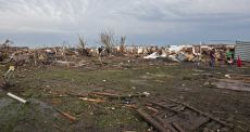 Stripped trees and destroyed houses remain after a huge tornado struck Moore, Oklahoma, near Oklahoma City, May 20, 2013. A massive tornado tore through the Oklahoma City suburb of Moore on Monday, killing at least 51 people as winds of up to 200 miles per hour (320 kph) flattened entire tracts of homes, two schools and a hospital, leaving a wake of tangled wreckage. REUTERS/Richard Rowe (UNITED STATES - Tags: DISASTER ENVIRONMENT)