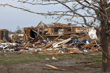 A destroyed house remains after a huge tornado struck Moore, Oklahoma, near Oklahoma City, May 20, 2013. A massive tornado tore through the Oklahoma City suburb of Moore on Monday, killing at least 51 people as winds of up to 200 miles per hour (320 kph) flattened entire tracts of homes, two schools and a hospital, leaving a wake of tangled wreckage. REUTERS/Richard Rowe (UNITED STATES - Tags: DISASTER ENVIRONMENT)