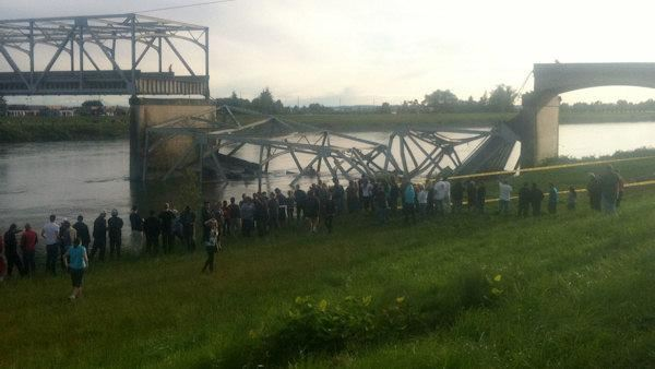 An Interstate 5 bridge over a river collapsed north of Seattle Thursday evening, dumping two vehicles into the water.