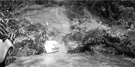 The cars have been buried in the landslide near the Bukit Nanas monorail station yesterday. (NST)