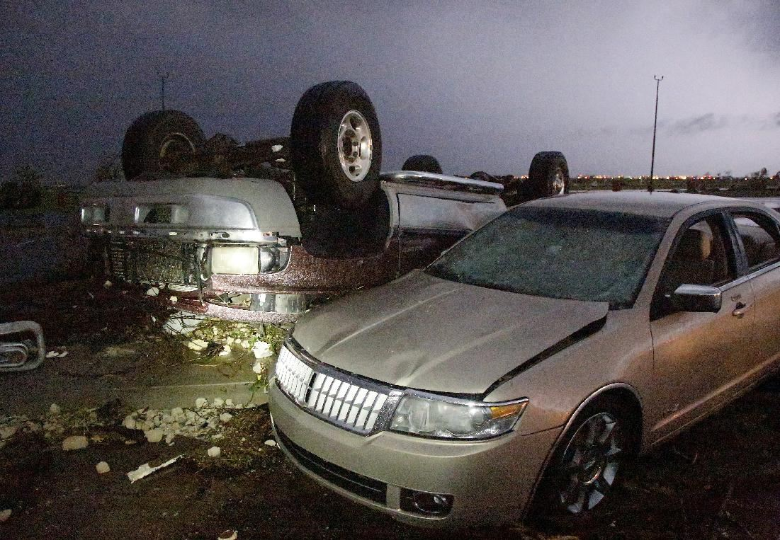 Cars that were damaged by a tornado in parking lot at Canadian Valley Technical Center on State Highway 66, west of Banner Road, Friday May 31, 2013 in El Reno, Okla. (AP Photo/The Oklahoman, Jim Beckel)