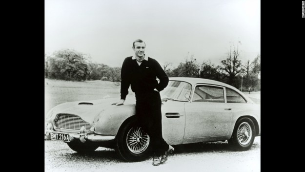 "The most iconic Aston Martin model -- and the one most frequently seen on screen -- is the DB5, produced from 1963 to 1965. Sean Connery first revved its engine in ""Goldfinger"" in 1964."