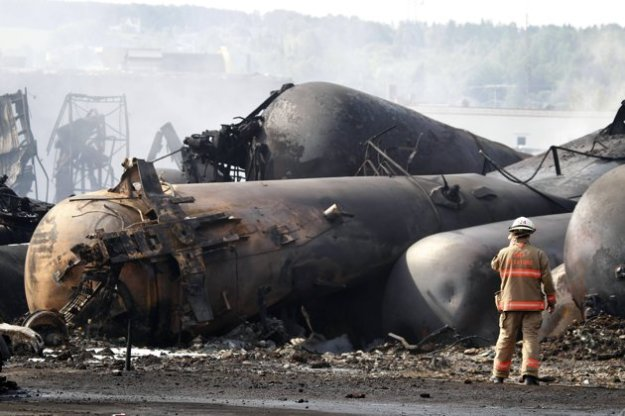 A firefighter walks past a burning train wagon at Lac Megantic, Quebec, July 6, 2013. Several people were missing after four tank cars of petroleum products exploded in the middle of a small town in the Canadian province of Quebec early on Saturday in a fiery blast that destroyed dozens of buildings. REUTERS/Mathieu Belanger (CANADA - Tags: DISASTER SOCIETY) A firefighter walks past the remains of buildings after a train explosion at Lac Megantic, Quebec, July 6, 2013. REUTERS/Mathieu Belanger (CANADA - Tags: DISASTER SOCIETY TPX IMAGES OF THE DAY) A burning train wagon is seen after an explosion at Lac Megantic, Quebec, July 6, 2013. REUTERS/Mathieu Belanger (CANADA - Tags: DISASTER SOCIETY) Firefighters look at a train wagon on fire at Lac Megantic, Quebec, July 6, 2013. Canadian police expect the death toll from a fatal fuel train blast in a small Quebec town to be more than the one person confirmed dead so far, a spokesman said on Saturday. The driverless train and 72 tankers of crude oil jumped the tracks in the small town of Lac-Megantic early in the morning and exploded in a massive fireball. REUTERS/Mathieu Belanger (CANADA - Tags: POLITICS ENERGY TPX IMAGES OF THE DAY BUSINESS) less  A cloud of smoke is seen over Lac Megantic after a train explosion, July 6, 2013. Several people were missing after four tank cars of petroleum products exploded in the middle of a small town in the Canadian province of Quebec early on Saturday in a fiery blast that destroyed dozens of buildings. REUTERS/Mathieu Belanger (CANADA - Tags: DISASTER SOCIETY) Fire from a train explosion is seen in Lac Megantic, July 6, 2013. At least five people died and 40 were missing on Sunday after the runaway train carrying crude oil exploded and destroyed the center of a small Canadian town in a disaster that raises fresh questions about shipping oil by rail. REUTERS/Stringer (CANADA - Tags: DISASTER TRANSPORT TPX IMAGES OF THE DAY) Homes are seen near the wreckage of a train derailment in Lac
