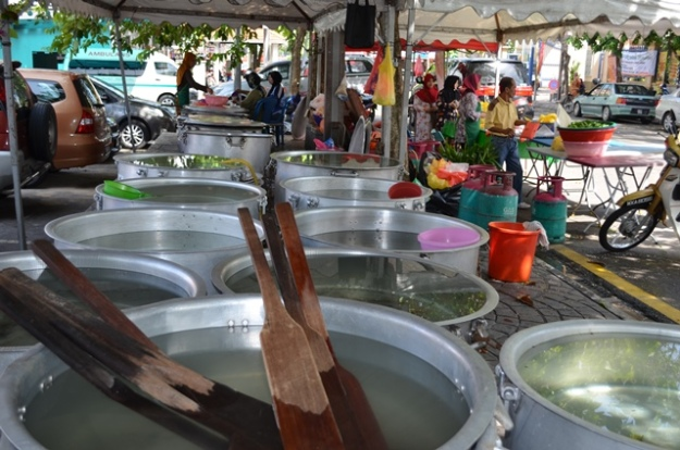 Rows of empty huge pots at about 11 a.m. on July 13, 2013.
