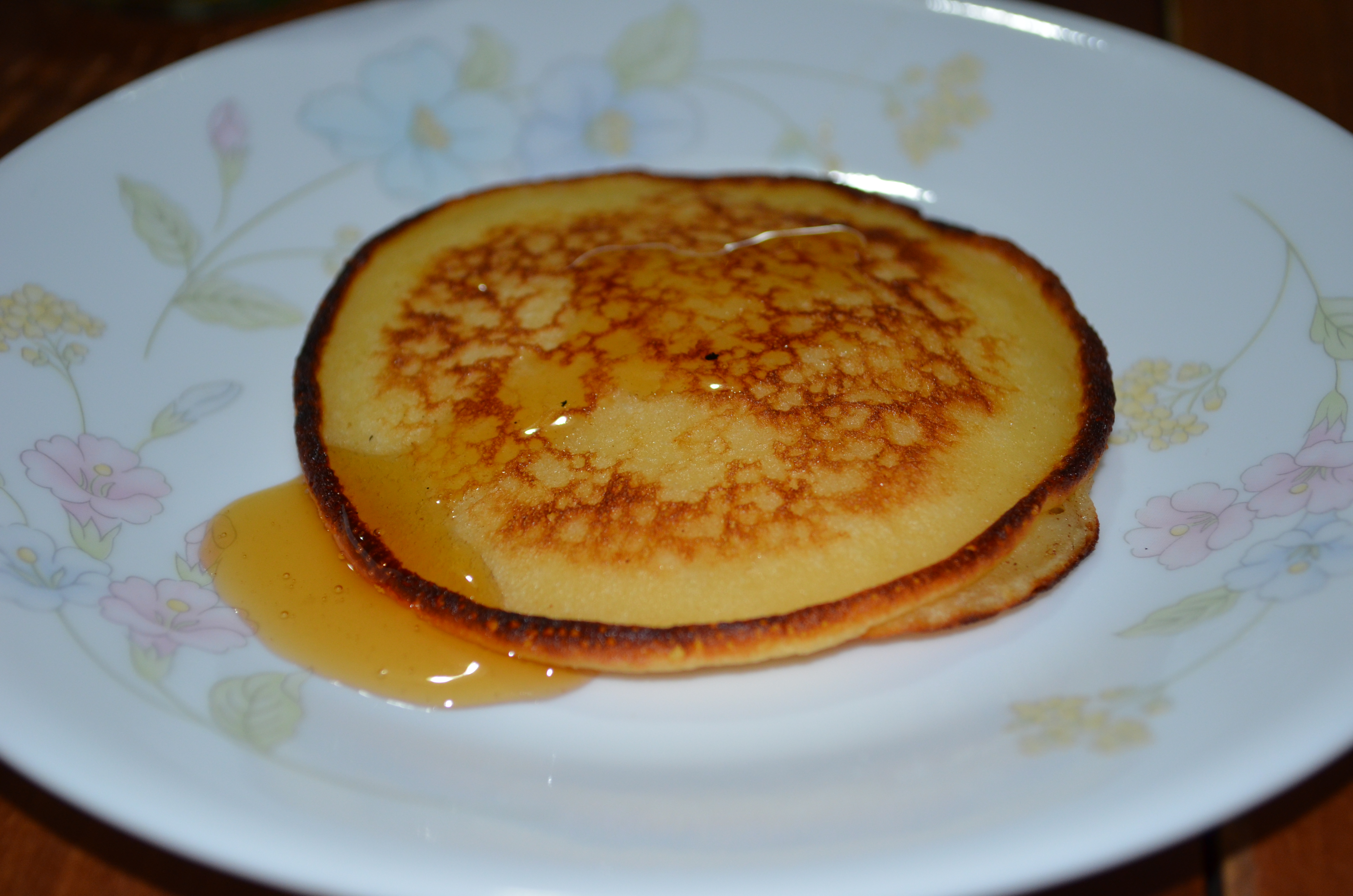 Crumpet and honey... a very tasty meal.