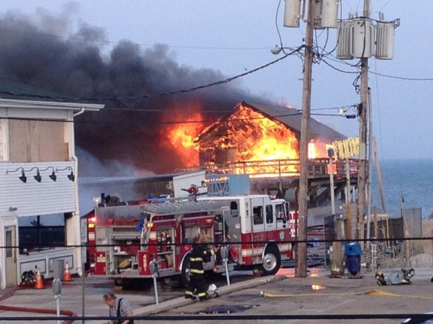 A massive fire raging for hours burned several blocks of boardwalk and businesses Thursday, Sept. 12, 2013 in a New Jersey shore town that was still rebuilding from damage caused by Superstorm Sandy.