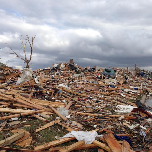A view of part of Washington, Ill. is seen from Mackenzie Street in Washington, Sunday, Nov. 17, 2013 after a tornado moved through the area. Intense thunderstorms and tornadoes swept across the Midwest on Sunday, causing extensive damage in several central Illinois communities while sending people to their basements for shelter and even prompting officials at Soldier Field in Chicago to evacuate the stands and delay the Bears game. (AP Photo/Alex Kareotes)