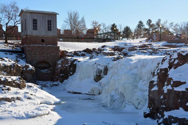 The waterfalls at Falls Park sit frozen with just a trickle of water flowing underneath, Sunday, Jan. 5, 2014, in Sioux Falls, S.D. The city and surrounding areas were under a wind chill advisory Sunday afternoon with wind chills levels expected to dip as low as 55 degrees below zero. (AP Photo/Dirk Lammers)