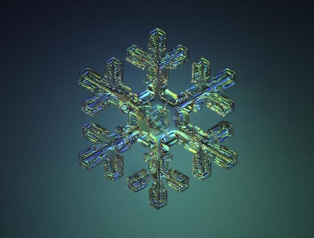 Macro view of snowflake with turquiose behind. (Valeriya Zvereva/CATERS NEWS)