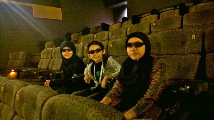 From left is my big sister Kashah, me, and my big sister Kafah wearing our 3D glasses before the movie started.