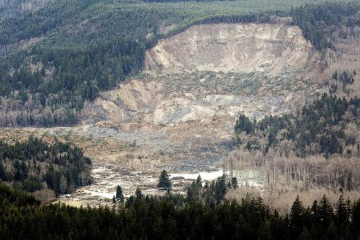 In this aerial photo taken Saturday, March 23, 2014, a massive mudslide is shown in between the towns of Darrington, Wash., and Arlington, Wash. The slide killed at least three people and many people are still unaccounted for, and authorities said Sunday that searchers were flying over the one-square-mile mudslide in helicopters. (The Seattle Times, Marcus Yam) MANDATORY CREDIT TO: MARCUS YAM/THE SEATTLE TIMES