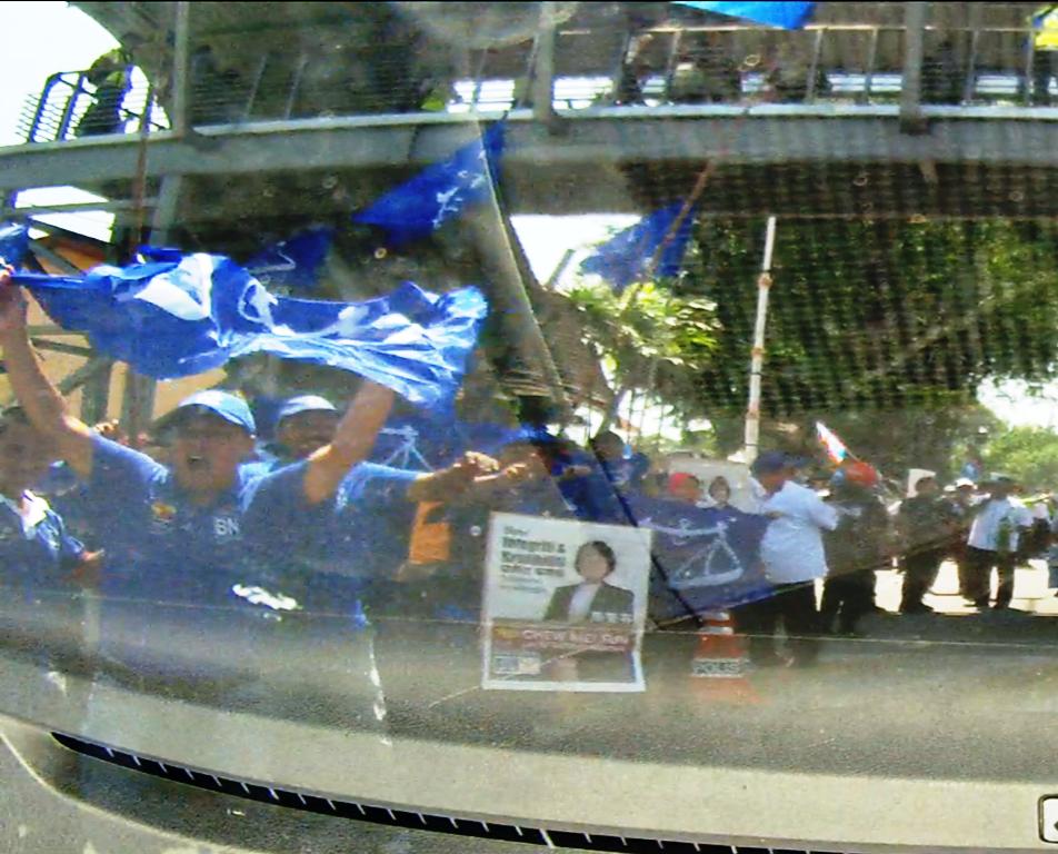 The BN team waving BN flags.
