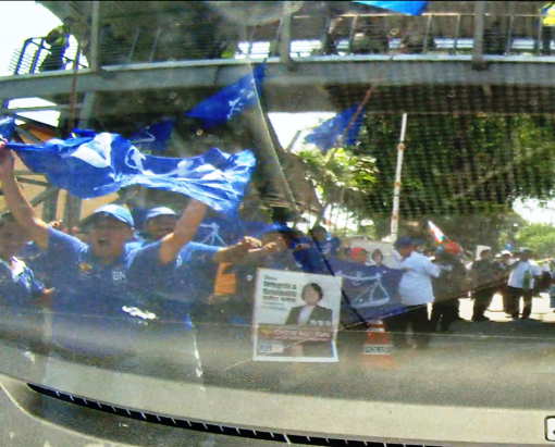 The BN team waving BN flags.