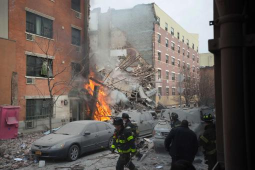 Firefighters work the scene of an explosion that leveled two apartment buildings in the East Harlem neighborhood of New York, March 12, 2014. (AP Photo/Jeremy Sailing)