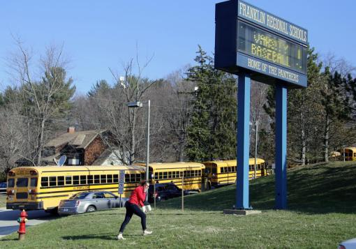 A woman walks onto the campus of the Franklin Regional School District where several people were stabbed at Franklin Regional High School on Wednesday, April 9, 2014, in Murrysville, Pa., near Pittsburgh. The suspect, a male student, was taken into custody and being questioned. (AP Photo/Gene J. Puskar)