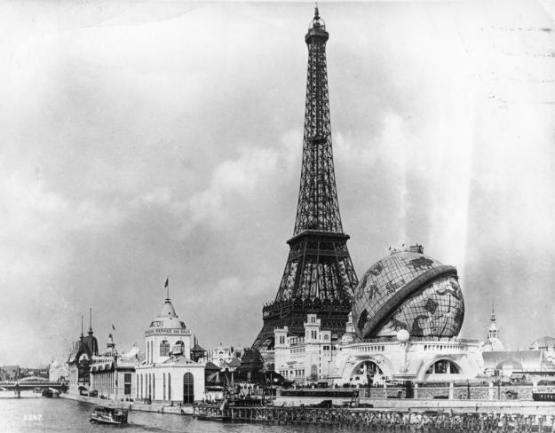 1889: View at the 'Exposition Universelle' across the River Seine towards the Eiffel Tower, and the 'Globe Celeste'. The Eiffel Tower, built to commemorate the 100th anniversary of the French Revolution, was the central focus of both the 1889 and the 1900 Paris Exhibition site.  (Photo by London Stereoscopic Company/Getty Images)