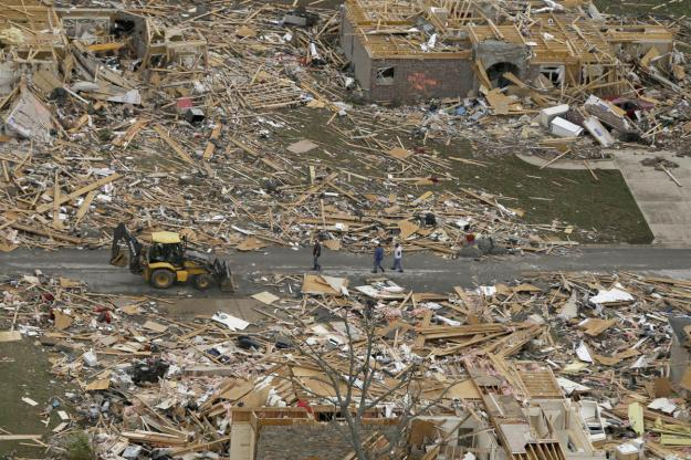 A debris trail, bottom, left when a tornado struck a Vilonia, Ark., neighborhood, leads from the rows of houses Monday, April 28, 2014, after a tornado struck the town late Sunday.  (AP Photo/Danny Johnston)