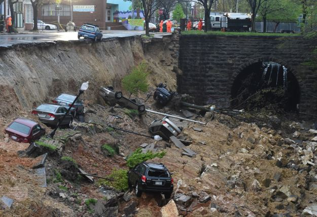 Streetlights, trees and cars have collapsed onto a train track in Baltimore. (Photo by Jonathan Newton / The Washington Post via Getty Images)