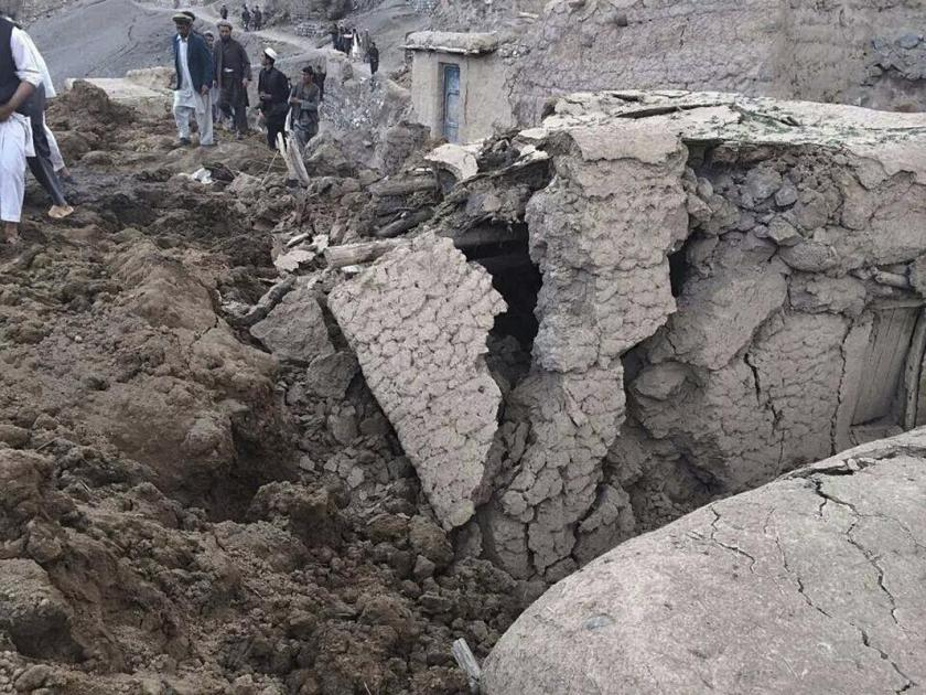 Afghan villagers gather at the site of a landslide at the Argo district in Badakhshan province, May 2, 2014. More than 2,000 people are trapped after a landslide smashed into a village in a remote mountainous area of northeastern Afghanistan on Friday, a spokesman for the local governor said, prompting a massive search and rescue effort. (REUTERS/Stringer)