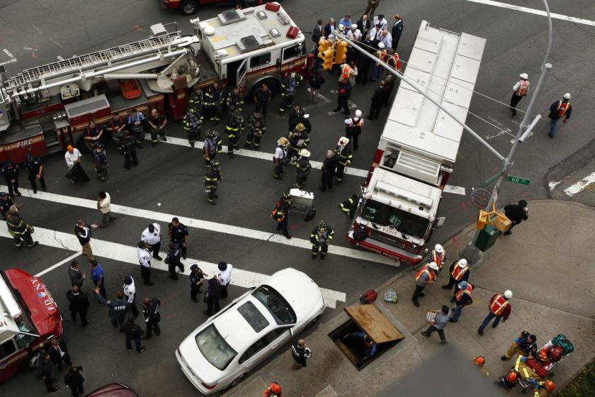 New York City firefighters and Metropolitan Transportation Authority (MTA) workers attend an emergency during a derailed F train in Woodside, New York, May 2, 2014. A New York City subway train carrying 1,000 riders derailed on Friday morning while traveling through a tunnel in the borough of Queens, injuring 19 people, city fire officials said. Fifteen people escaped with minor injuries while four more were transported to a hospital with potentially serious injuries, officials said. (REUTERS/Eduardo Munoz)