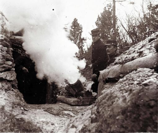An undated archive picture shows French soldiers firing a 155 mm mortar from a trench on the front line, at an unknown location in France. (REUTERS/Collection Odette Carrez)