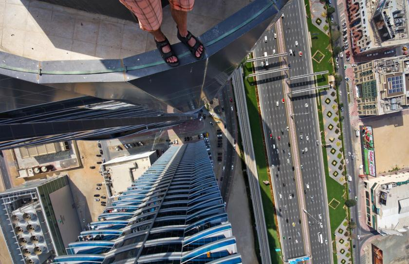 One of the Daredevils legs dangling from a building in Dubai. (Alexander Remnex/Caters News)