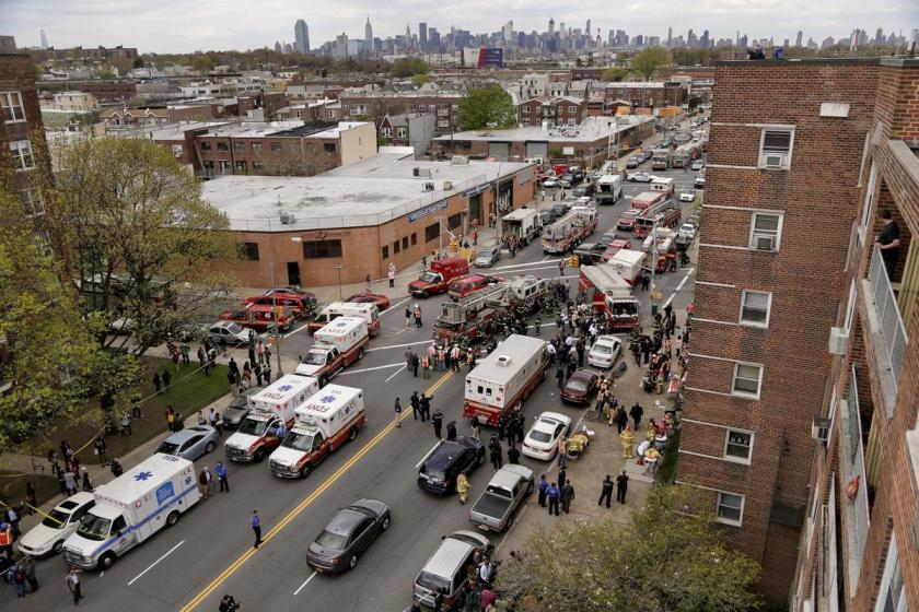 New York City emergency crews converge at 60th Street and Broadway to evacuate passengers from a subway train after it derailed in the Queens borough of New York, Friday, May 2, 2014. (AP Photo/Julie Jacobson)