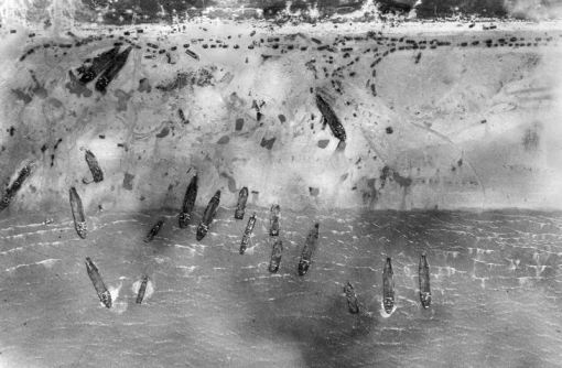 On Omaha Beach 70 years ago, US Army troops fought against the German 352nd Infantry Division. (MoD) Troops land on Gold beach on 6 June 1944 - D-Day. This image was taken by a photo reconnaissance Mustang aircraft of II (Army Cooperation) Squadron. (MoD)