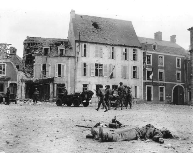 The body of a dead German soldier lies in the main square of Place Du Marche after the town was taken by U.S. troops who landed at nearby Omaha Beach in Trevieres, France, June 15, 1944. (REUTERS/US National Archives)
