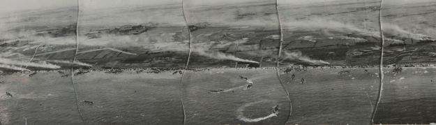 On Omaha Beach 70 years ago, US Army troops fought against the German 352nd Infantry Division. (MoD) In an image taken at 800ft above the coast, French villages are left in flames as the Allied forces move in. (MoD) Troops land on Gold beach on 6 June 1944 - D-Day. This image was taken by a photo reconnaissance Mustang aircraft of II (Army Cooperation) Squadron. (MoD)