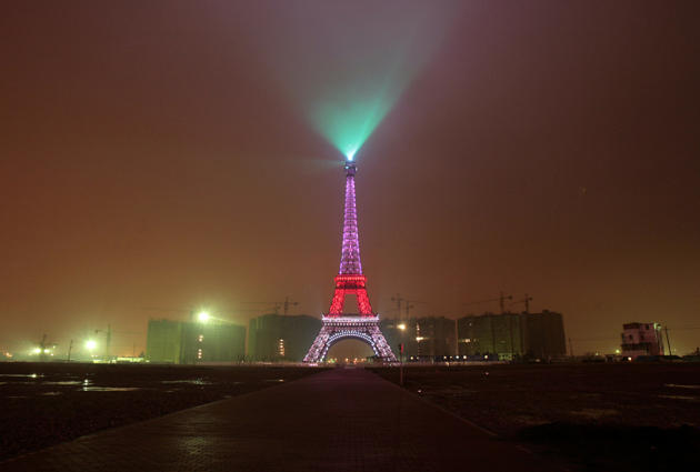 CHINA: A replica of the Eiffel Tower lights up on the outskirts of Hangzhou, Zhejiang province December 22, 2007. (REUTERS)