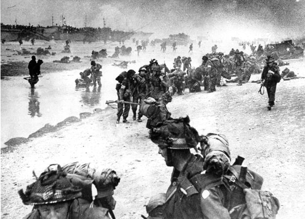 British troops move on the Normandy shore from their landing craft on June 6, 1944 during the huge invasion. (PA
