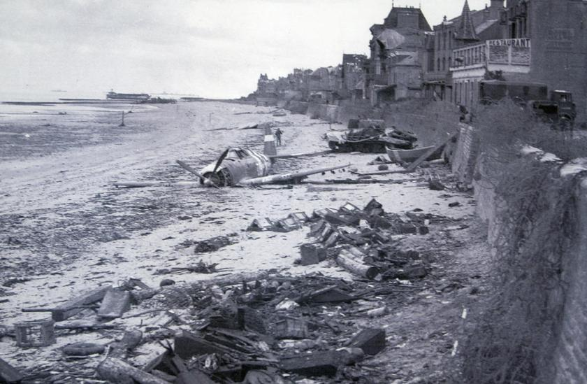 A crashed U.S. fighter plane is seen on the waterfront some time after Canadian forces came ashore on a Juno Beach D-Day landing zone in Saint-Aubin-sur-Mer, France, in June 1944. (REUTERS/US National Archives)