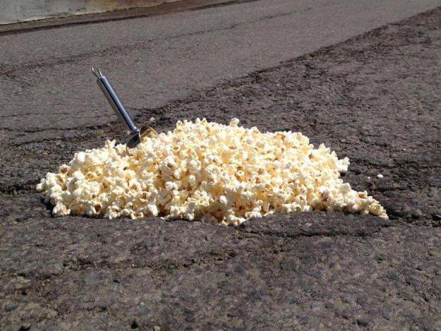 And they dived straight in - creating everything from a pothole bowl of cereal for breakfast to a popcorn machine. Pictured: Popcorn machine pothole. (Caters News)