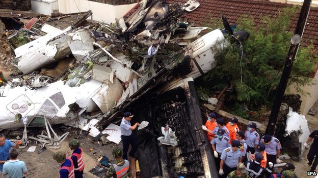 The plane came down in buildings in a village near Magong airport in Penghu