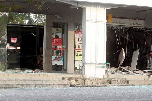 The damaged service area at a bank in Bukit Beruntung after the homemade bomb expotion on Tuesday. (Photo by The Star)