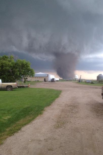 A tornado touches down near Outlook, Sask., on Saturday, July 5, 2014. Residents in parts of Saskatchewan ran for cover, stared in awe or jumped in their trucks to follow what Environment Canada says were several tornadoes that hit Saturday. The agency issued tornado warnings for numerous areas in south-central Saskatchewan Saturday afternoon, and said there were tornadoes reported near Outlook and Kenaston. THE CANADIAN PRESS/HO - Jessica Kubashek